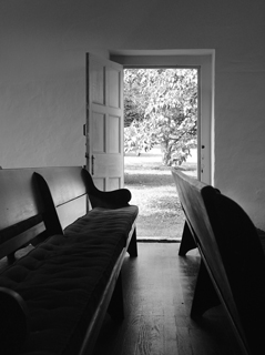 Meetinghouse benches with open door